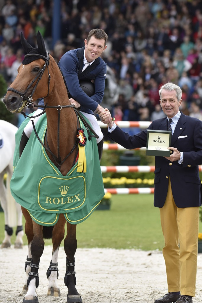 Scott Brash and Hello Sanctos after their victory in the Rolx Grand Prix receive Rolex watch